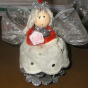 An angel pinecone Christmas ornament