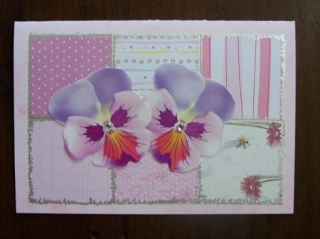 Special occasion card with pink patchwork pink squares and pansies.
