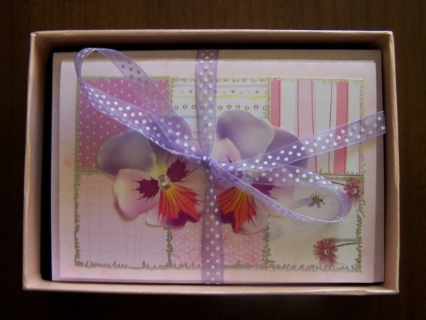Box of cards tied with lavender polka dot bow.