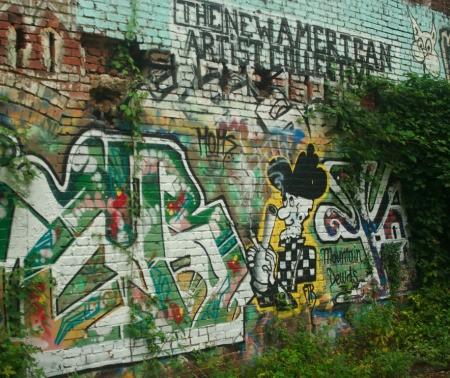 Graffiti on old brick wall.