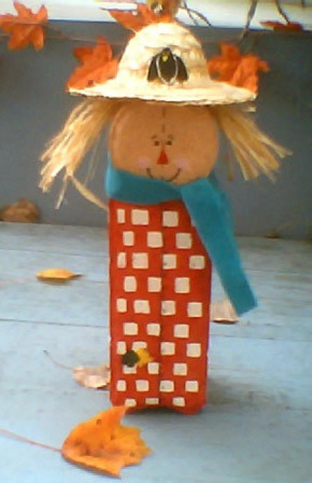 Scarecrow made from patio pavers.