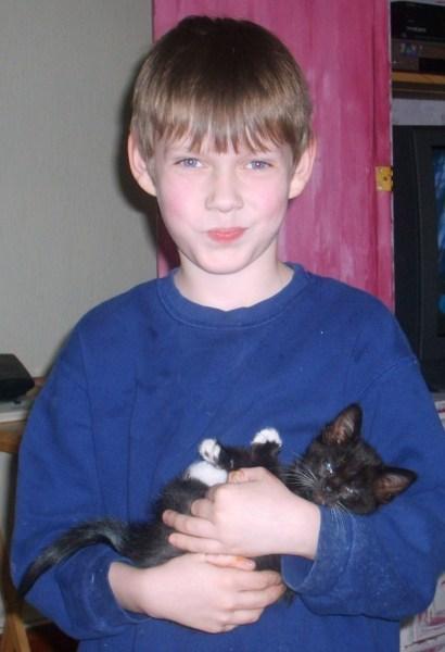 Boy holding kitten.