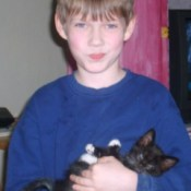 Boy holding kitten.
