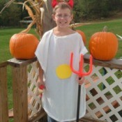Boy in deviled egg costume.