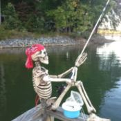 Skeleton fishing from deck.