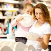 Mother and Daughter Shopping for Dishes