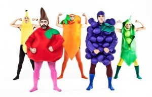 A group of men dressed up like fruit.