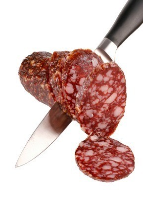 Knife Cutting Summer Sausage