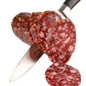 Knife Cutting Summer Sausage