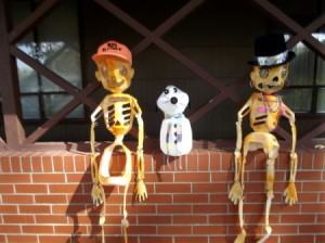 Decorations sitting on patio wall.