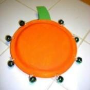 Paper plate tambourine.