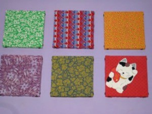 Examples of wall hangings made with scrap fabrics.