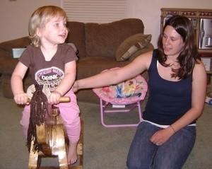 Child on rocking horse.