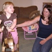 Child on rocking horse.