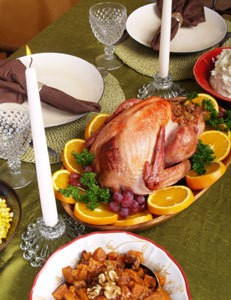 Thanksgiving table with a roasted turkey