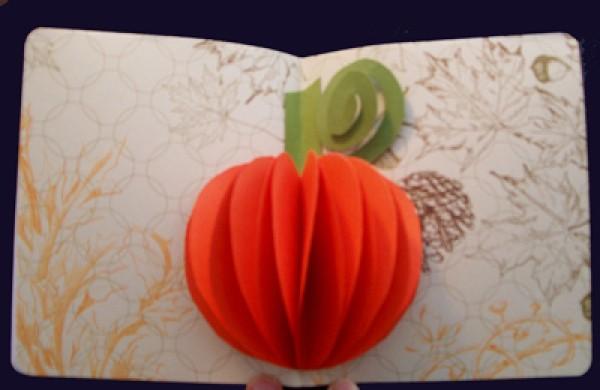 A popout orange pumpkin card