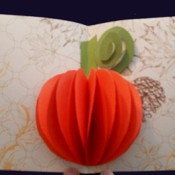 A popout orange pumpkin card
