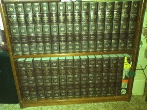 Encyclopedias on bookshelf.