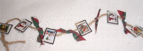 Crafts Made from Christmas Seals - Garland made with seals, cord, and plaid Christmas bows.