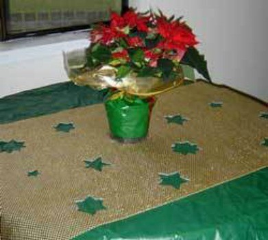 Table runner with cut outs.