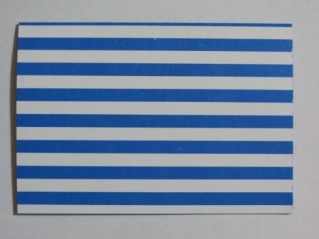 Score the blue and white striped cardstock length-wise.