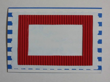 Position and glue the red corrugated frame to the front of the card.