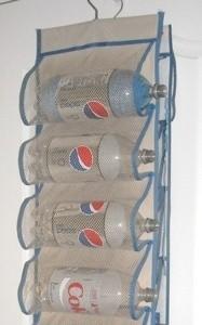 Pop bottles on door shoe holder for yarn storage.