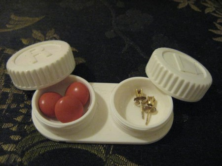 Case with pills and earrings.