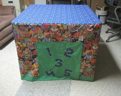 A playhouse slipcover over a card table