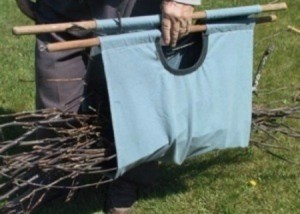 Tote being used to carry twigs.