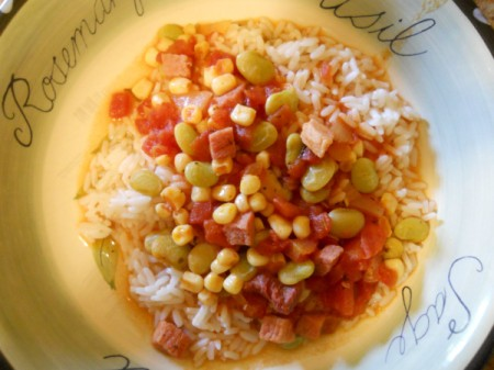 Bowl of succotash over rice.