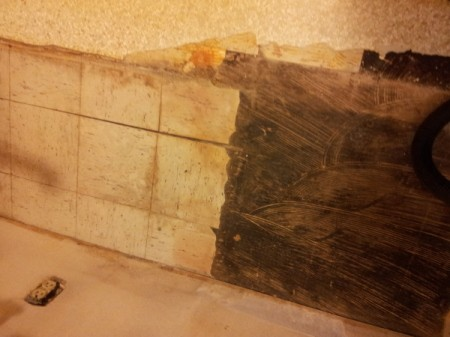 View of old tiles and adhesive.