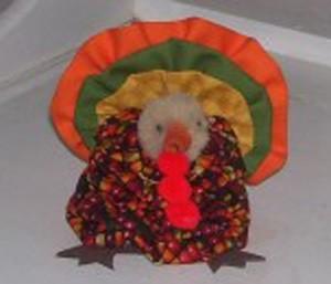Fall fabric yo yo turkey table decoration.