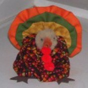 Fall fabric yo yo turkey table decoration.