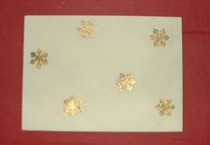 Envelop with gold snowflakes.
