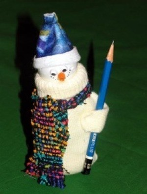 A decorative snowman figure made from a mitten.