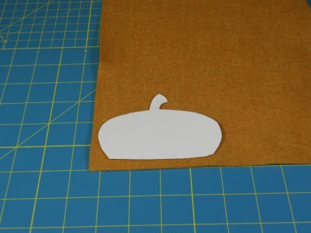 Acorn cap template on felt square.