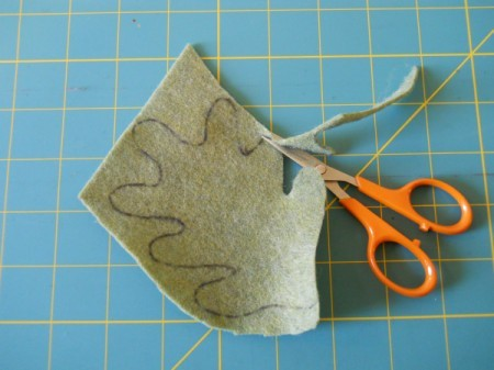 Cutting out felt leaf.