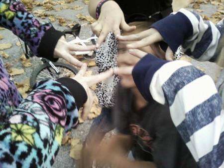 Children's hands making a star.