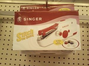 Singer hand held sewing machine.