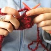 A woman holding yarn.
