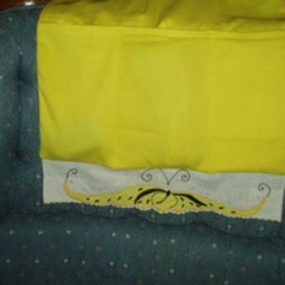Telephone and Remote Caddy made from yellow fabric.