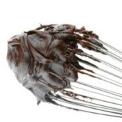 A whisk with hot fudge on it.