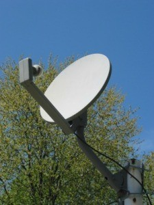 A DIRECTV style dish on a rooftop.