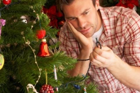 A man repairing Christmas tree lights. - Christmas Lights Not Working ThriftyFun