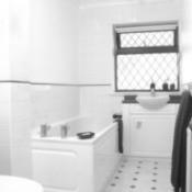 A bathroom with ceramic tile.