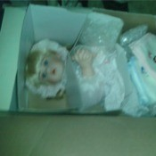 Doll in box.