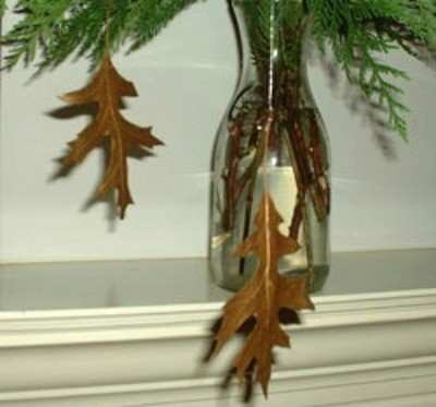 Leaves hanging from evergreen garland.