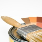 A paint bucket and paint swatches.