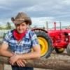 A photo of a cowboy on a farm.